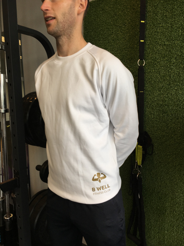 B Well Fitness Trainer Peter wearing the Raglan sweat crew neck